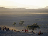 Scene at a Maasai Manyatta, or Homestead, at Dawn in an Arid Part of Northern Tanzania Photographic Print by Nigel Pavitt
