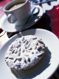 Pine Nut Cakes Dusted with Icing Sugar and Served with Coffee are a Local Speciality Photographic Print by Ian Aitken