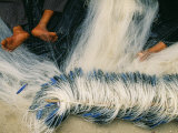 Detail of Feet Being Used to Repair Fishing Nets, Vietnam Photographic Print by Paul Harris