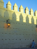 Woman Walks under the Ancient City Walls of Fez, Morocco Photographic Print by Julian Love