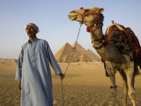 Camel Driver Stands in Front of the Pyramids at Giza, Egypt Photographic Print by Julian Love