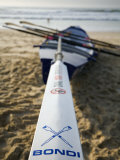 New South Wales, Sydney, A Surfboat Sits on Beach at Bondi in Sydney&#39;s Eastern Beaches, Australia Photographic Print by Andrew Watson