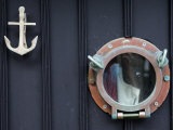 Door of Fisherman&#39;s Cottage - Anchor for Door Knocker and Ship&#39;s Porthole for a Peephole, Cornwall Photographic Print by John Warburton-lee