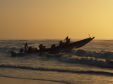 Fishermen Launch their Boat into the Atlantic Ocean at Sunset Photographic Print by Amar Grover