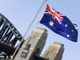 An Australian Flag Flutters in Breeze in Front of Iconic Sydney Harbour Bridge, Sydney Photographic Print by Andrew Watson