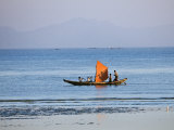 Tthe Crew of Small Fishing Boat Hurries Home to Sittwe Harbour with their Catch, Burma, Myanmar Photographic Print by Nigel Pavitt