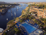 Aswan in Late Afternoon, Old Cataract Hotel in front, Where Agatha Christie Wrote Death, Nile Fotografie-Druck von Julian Love