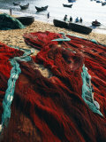 Fishing Nets Laid Out on the Beach after the Day's Wor Photographic Print by Paul Harris