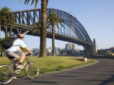 An Early Morning Cyclist Rounds Daves Point Reserve at Foot of Harbour Bridge, Sydney, Australia Photographic Print by Andrew Watson