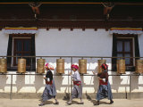 Mosu Women Push Prayer Wheels at a Small Monastery on Liwubi Island, China Photographic Print by Amar Grover