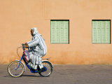 Man with Bicycle Infront of Red Rose Walls and Minaret Photographic Print by Christian Kober