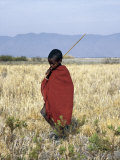 Young Boy of the Datoga Tribe Crosses the Plains East of Lake Manyara in Northern Tanzania Fotografie-Druck von Nigel Pavitt