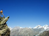 Hiker High on Trail Above Snow Capped Mountains, Zermatt, Valais, Switzerland Photographic Print by Christian Kober