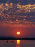Lower Zambesi National Park, Canoeing on the Zambezi River at Sun Rise under a Mackerel Sky, Zambia Photographic Print by John Warburton-lee