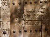 Inscription on the Wooden Door of the Souq at Nizwa Photographic Print by John Warburton-lee