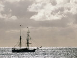 Sailing Ship Anchored in Front of Hanga Roa, Easter Island's Main Settlement Photographic Print by John Warburton-lee