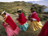 Aymara Women Dance and Spin in Festival of San Andres Celebration, Isla Del Sol, Bolivia Photographic Print by Andrew Watson
