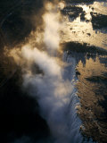 Aerial View of Zambezi River as it Plummets over the Victoria Falls Photographic Print by John Warburton-lee