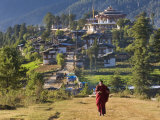 Monk Leaving Gangtey Dzong, and Village, Phobjikha Valley, Bhutan Photographic Print by Peter Adams