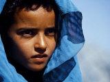 Young Girl in Characteristic Saharan Blue Headscarf Looking into Distance, Sahara, Southern Morocco Papier Photo par Mark Hannaford