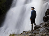 Hiker Enjoys Fergusson Falls on the Overland Track, Tasmania Photographic Print by Julian Love