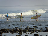 Surfers Head into the Surf at Mancora on the Northern Coast of Peru Photographic Print by Andrew Watson