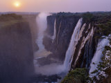 Sunset over Magnificent Victoria Falls, One of Natural Wonders of World Fotografisk tryk af Nigel Pavitt
