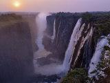 Sunset over Magnificent Victoria Falls, One of Natural Wonders of World Fotografie-Druck von Nigel Pavitt