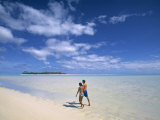 Couple on a Beach, Aitutaki, Cook Islands Photographic Print by Neil Farrin