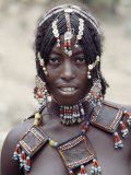 Young Afar Girl at Senbete Market, Her Elaborate Hairstyle and Beaded Jewellery Photographic Print by Nigel Pavitt