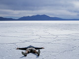 Tourist on Salt Crust of Salar De Uyuni, Emphasising Scale of Largest Salt Flat in World, Bolivia Photographic Print by John Warburton-lee