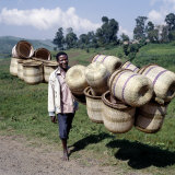Man Carries Traditional Split-Bamboo Baskets to Sell at Kisoro Market, Southwest Uganda Photographic Print by Nigel Pavitt