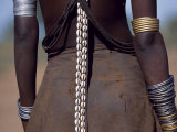 Young Dassanech Girl Wears a Leather Skirt, Metal Bracelets, Amulets and Bead Necklaces, Ethiopia Lámina fotográfica por John Warburton-lee