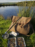 Wales, Conwy, A Trout Rod and Fly Fishing Equipment Beside a Hill Lake in North Wales, UK Fotografisk trykk av John Warburton-lee