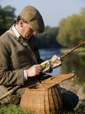 Wrexham, A Fisherman Selects a Fly While Salmon Fishing on the River Dee, Wales Photographic Print by John Warburton-lee