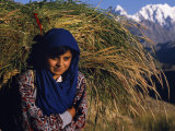 Burusho Girl Returns Home with Fodder for Her Livestock in the Hunza Valley Photographic Print by Amar Grover