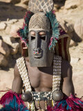 Dogon Country, Tereli, A Masked Dancer Wearing Coconut Shell Breasts Performs at the Dogon Village  Papier Photo par Nigel Pavitt
