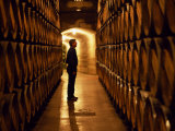 Foreman of Works Inspects Barrels of Rioja Wine in the Underground Cellars at Muga Winery Photographie par John Warburton-lee