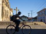 Granada, Man Riding Bike Past Iglesia De La Merced, Nicaragua Photographic Print by Jane Sweeney