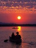 Canoeing at Sun Rise on the Zambezi River Photographic Print by John Warburton-lee