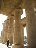 Man Walks Underneath the Giant Columns of the Hypostyle Hall in the Ramesseum, Luxor Photographic Print by Julian Love