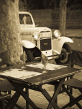 Colonia Del Sacramento, Cafe Table and Old Car, Uruguay Photographic Print by Walter Bibikow