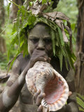 Tanna Island Fetukai, Native Dress-Young Boy with Sea Shell Horn, Vanuatu Photographic Print by Walter Bibikow