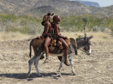Two Happy Himba Girls Ride a Donkey to Market, Namibia Lámina fotográfica por Nigel Pavitt