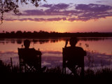 Sundowners at Tongabezi, Looking across the Zambezi River Photographic Print by John Warburton-lee