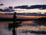 Zambia Game Scout Poling Mokorro Along Lukulu River at Sunset Photographic Print by John Warburton-lee