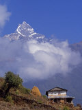 Hillside House with the Fishtail Peak of Machhapuchhare 6, 993 Metres Behind Photographic Print by Mark Hannaford
