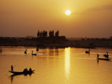 Boats Plying the River with the Sun Sinking Behind Them and the Far Bank of the River Niger Photographic Print by Mark Hannaford