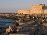 Friends and Couples Gather at Sunset Outside the Citadel of Quatbai, Alexandria, Egypt Photographic Print by Julian Love