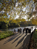 People Enjoy an Autumn Walk in St James's Park in Autumn Photographic Print by Julian Love